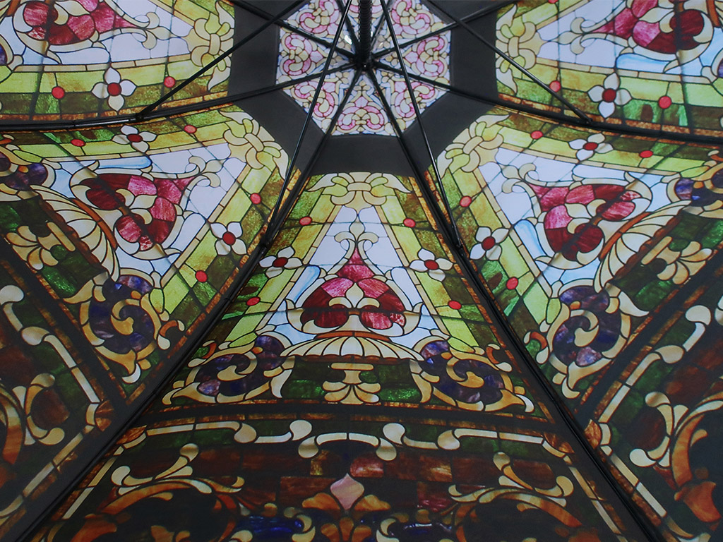 Stained glass window print on inside of umbrella