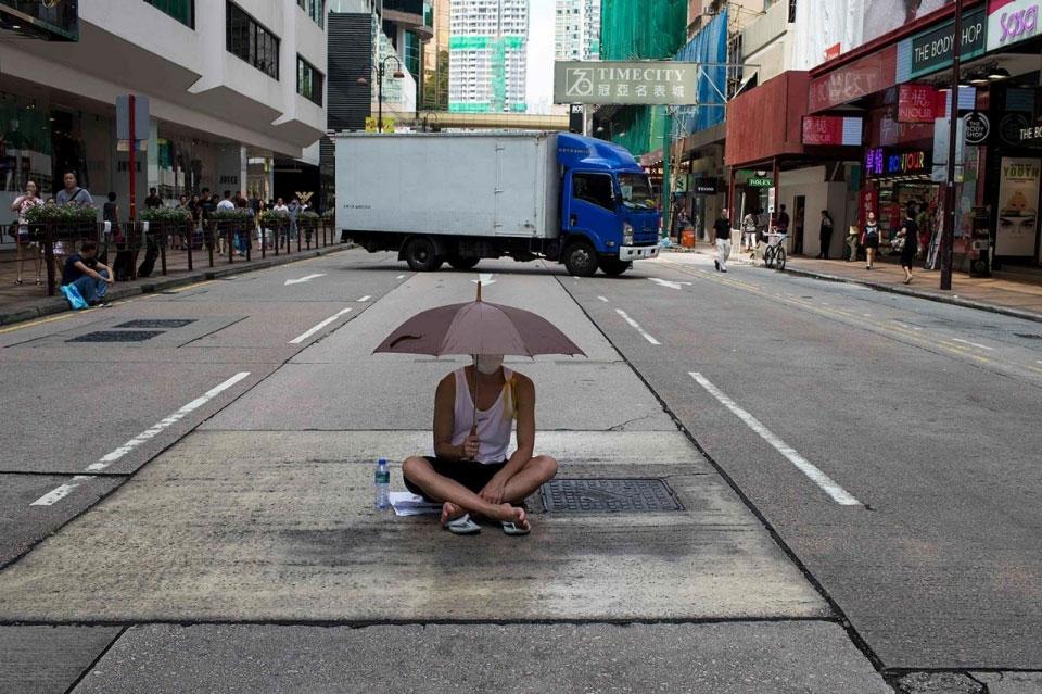 Man with Umbrella in Hong Kong