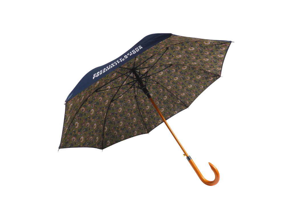 Floral print on inside of wood walker umbrella