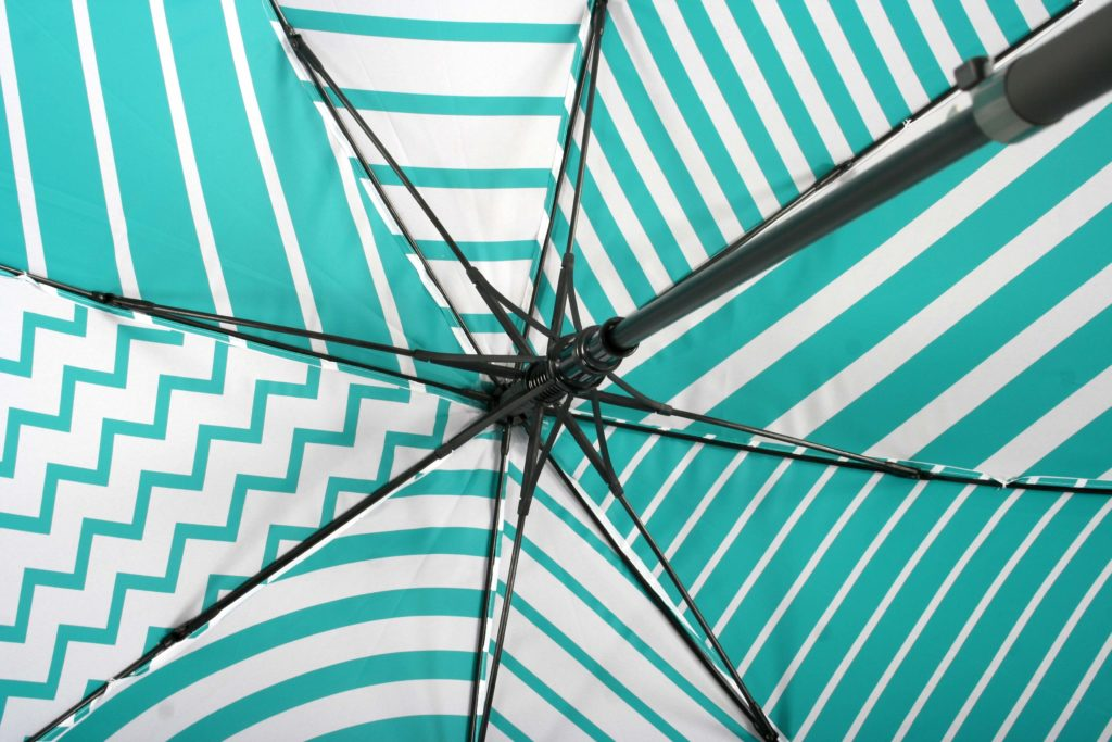 Geometric print umbrella in bright stripes