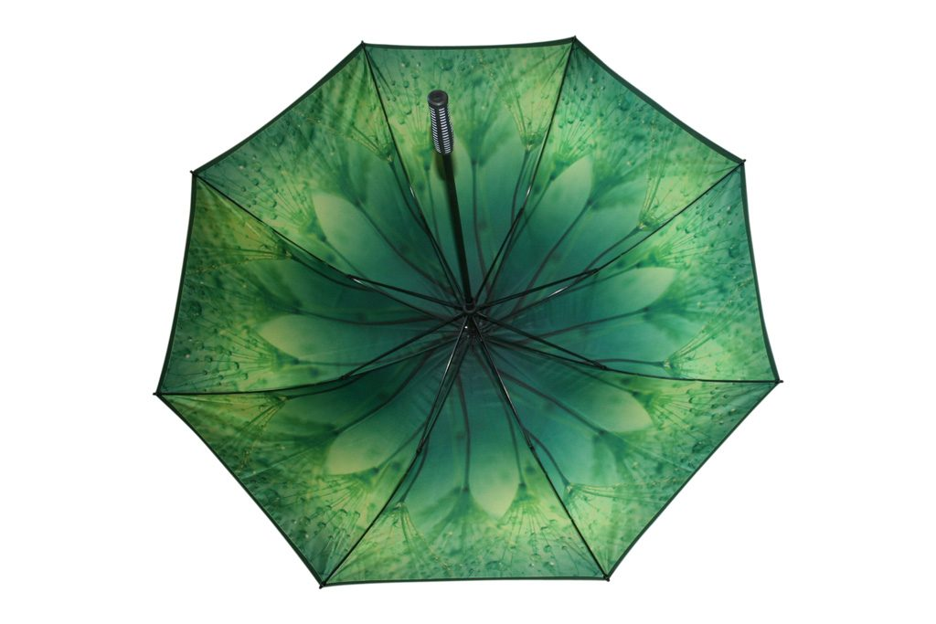 Green floral graphic print on underside of customised umbrella