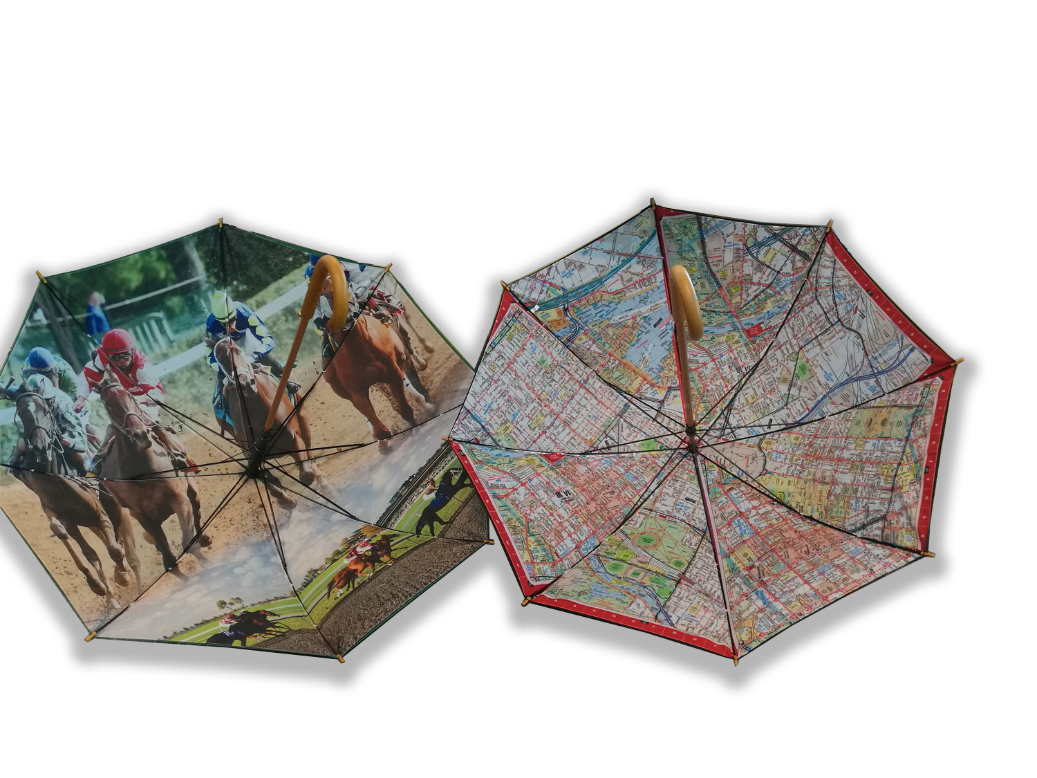 two open umbrellas one with horses racing on the inside and one with a map across the inside of umbrella